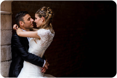 bride and groom hugging during wedding photo service