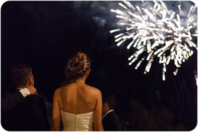 married couple watch firecrackers during wedding photo service